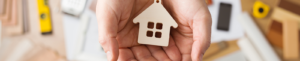 image of hands holding home