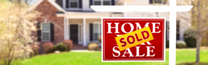 image of sold sign in front of home