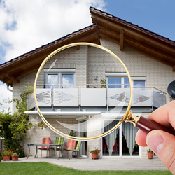 image of house with magnifying lens