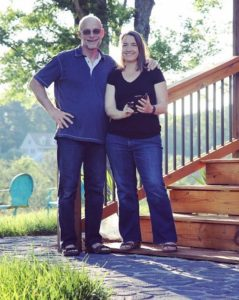 image of couple in front of house monica and michael van hall